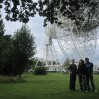 Myles, Laura and John posing in front of the Lovell Telescope