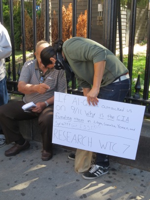 A truther adding more to his sign