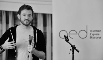 A picture of me giving a cut-down version of my talk at QED taken by Al Johnston
