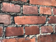 Auschwitz name on brick